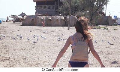 Girl running at sea