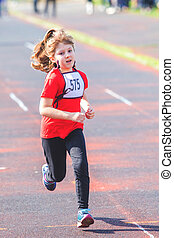 girl running during a race