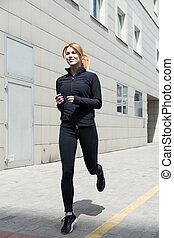Girl running in the city
