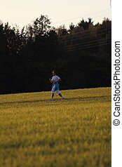 girl running on a meadow