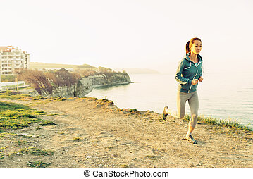 Girl running on coast