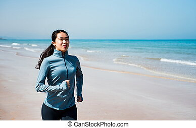 Girl running on the beach at morning