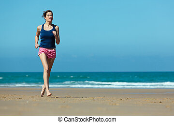Girl running on the beach in barefoot