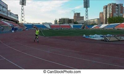 Girl running on the treadmill at a sports stadium