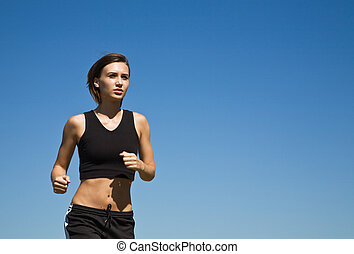 Girl running outdoor - A shot of a caucasian girl running...