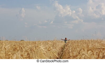 girl running through the wheat field