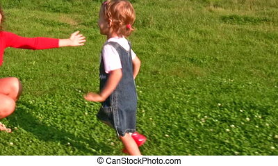 Girl running to embrace mother