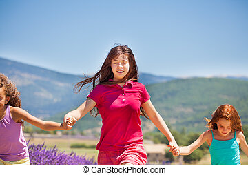 Girl running with her friends in lavender field