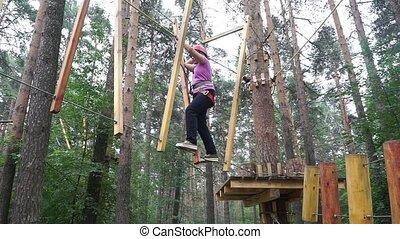 Girl runs along the obstacle course - Girl runs along the...