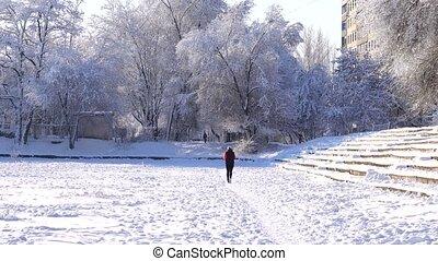 girl runs at stadium in the winter