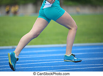 girl runs faster around the track during a sports competition