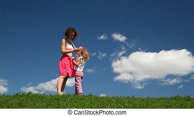 Girl runs from mother on field