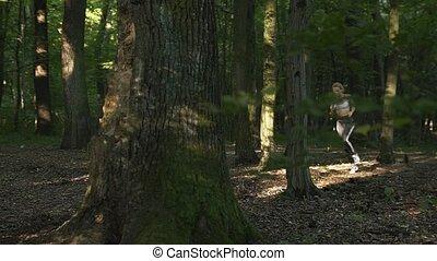 Girl Runs in the Morning Woods