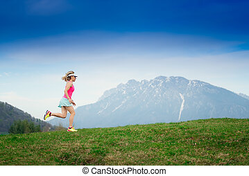 Girl runs in the mountains