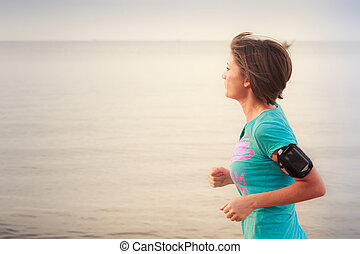 girl runs on beach at low tide