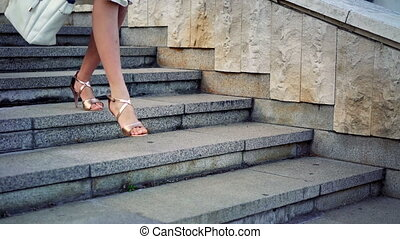 Girl runs on steps high heels stiletto street city outdoor -...