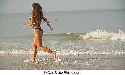 girl runs on the sea