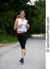 Girl runs through forest