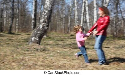 girl runs to her mother and throws into her arms - little...