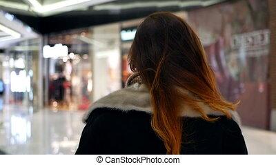 Girl sale walk shopping - Beautiful girl trying dress room...