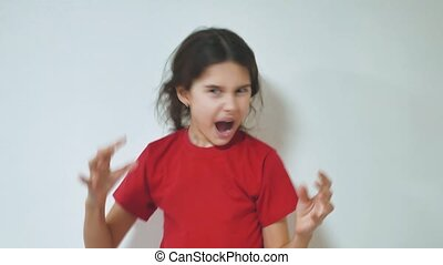 girl screaming opened her mouth. Portrait of adorable...