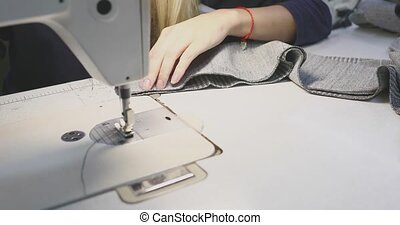girl seamstress working for a sewing machine.