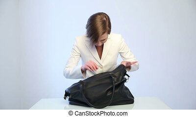 girl searching for a phone in her bag