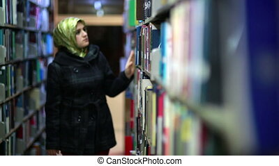 Girl searching for books