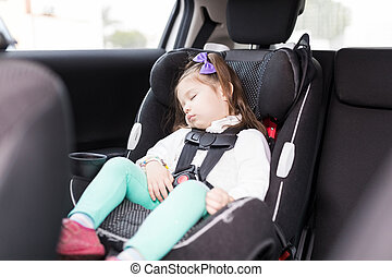 Girl Secured With Seat Belts Resting In Car