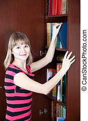 Girl selecting book