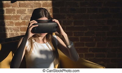 Girl Sets off Virtual Reality Helm - Pleased dark hair...