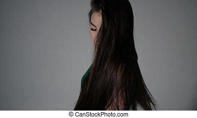 girl shakes dark hair - green dancer shakes her head