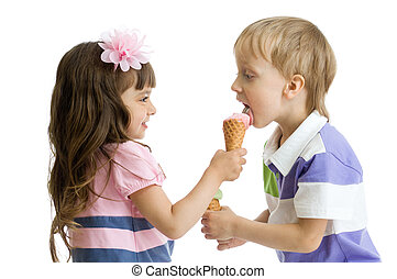 girl shares, gives or feeds boy with her ice cream in studio...
