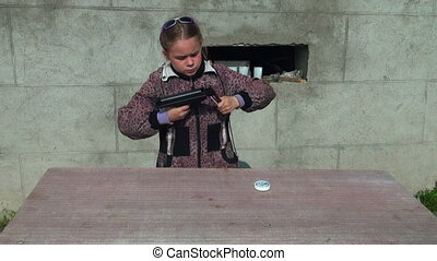 Girl shoots a gun