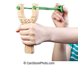 girl shoots from simple wooden slingshot
