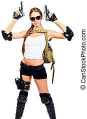 girl - Shot of a sexy military woman posing with guns....