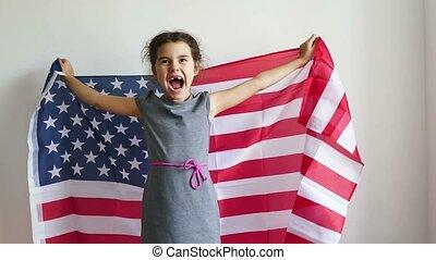 girl shouting teen holding American flag usa - girl shouting...
