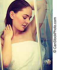 Girl showering in shower cabin