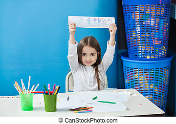 Girl Showing Drawing In Classroom