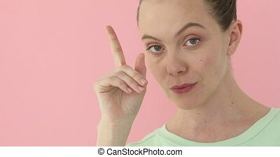 Girl showing hand gesture - Confident girl shows finger you