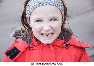 girl showing teeth