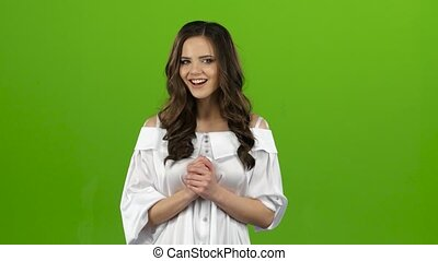 Girl shows a finger up winks and sends a kiss. Green screen...