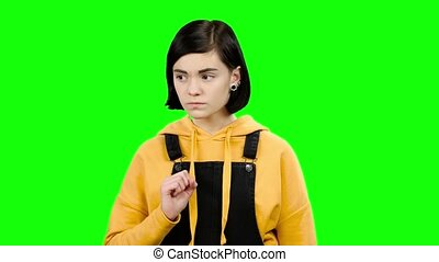 Girl shows a soft finger. Green screen - Girl shows quietly...
