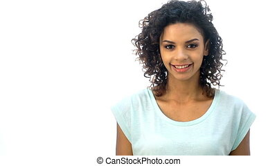 African or African-American, a mulatto girl shows emotions of thought, points a finger at up copy space. Beautiful woman face. Perfect toothy smile. African or african-american young girl portrait. Isolated on white background. Happy positive girl exhibit different emotions on a white background.