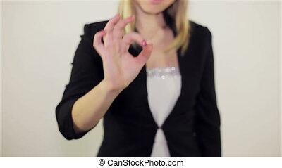 Girl shows gesture ok