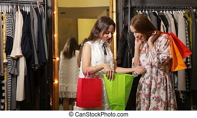 Girl Shows Purchase to Friend