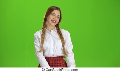 Girl shows the heart shape. Green screen - Girl shows the...