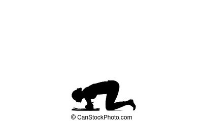Girl shows the pose headstand. Silhouette