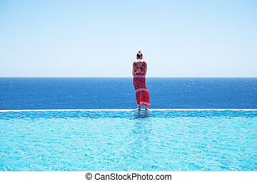 Girl silhouette by the swimming pool