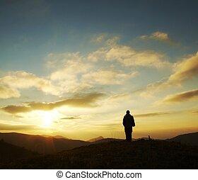 Girl silhouette on sunrise
